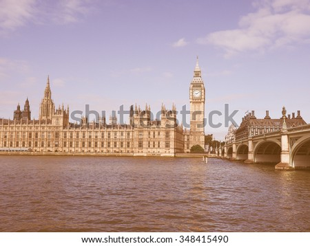 Vintage looking Houses of Parliament aka Westminster Palace in London, UK - stock photo