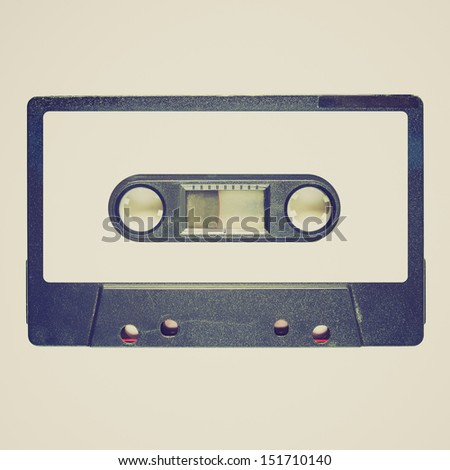 Vintage looking Magnetic tape cassette for audio music recording - isolated over white background - blank label - stock photo