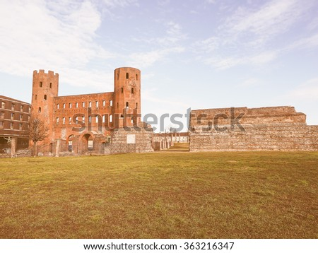 Vintage looking Palatine towers Porte Palatine ruins of ancient roman town gates and wall in Turin