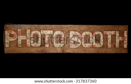 Vintage looking photo booth sign on black background - stock photo