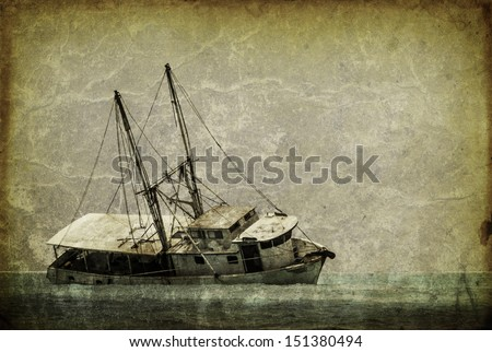 Vintage looking picture of a capsized fishing boat in the caribbean - stock photo