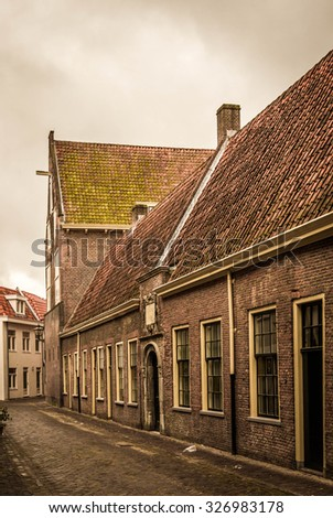 Vintage looking picture of a narrow street in Leiden, Holland - stock photo