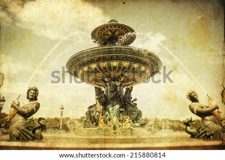 vintage looking picture of the antique fountain on the Place de la Concorde in Paris, France