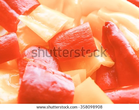 Vintage looking Red and yellow peppers useful as a food background