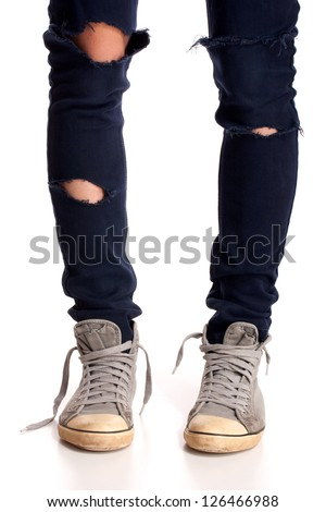Vintage looking sneakers and ripped jeans - stock photo