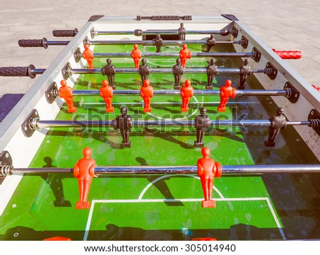 Vintage looking Table football aka table soccer, foosball from the German Tischfussball, baby-foot or kicker table-top game and sport - stock photo