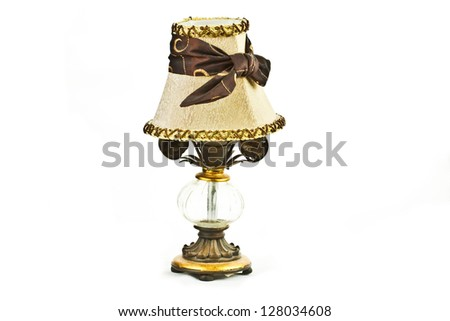 Vintage looking table lamp over white background - stock photo