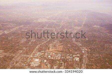 Vintage looking The San Fernando Valley aka The Valley in the Los Angeles metropolitan area of southern California defined by the mountains of the Transverse Ranges circling it - stock photo