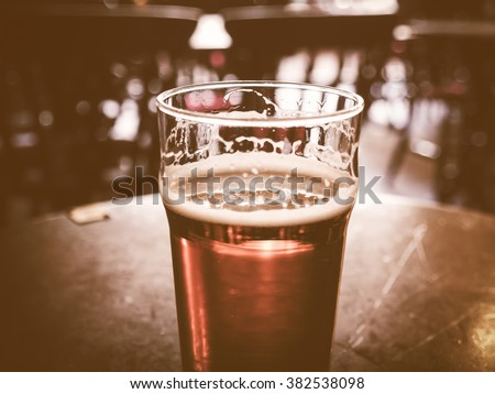 Vintage looking Vintage looking pint of English bitter ale in a pub - stock photo