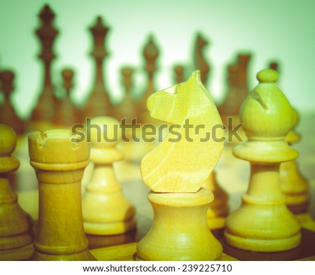 Vintage looking Wooden chessboard with light and dark wood checkers - stock photo