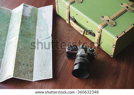 Vintage luggage, film camera and map for travel concept - stock photo