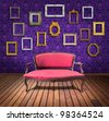 vintage luxury armchair and frame in purple wallpaper room - stock photo