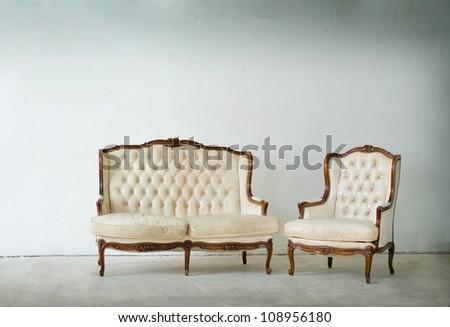 vintage luxury armchair in white room - stock photo