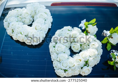 Vintage luxury Wedding Car Decorated with Flowers. - stock photo
