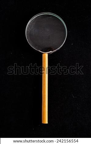 Vintage Magnify Glass Loupe on a Black Background - stock photo