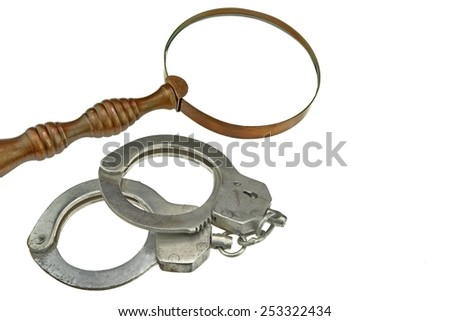 Vintage Magnifying Glass and Handcuffs Isolated On  White Background - stock photo