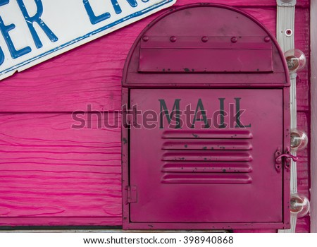vintage mailbox on wood wall - stock photo