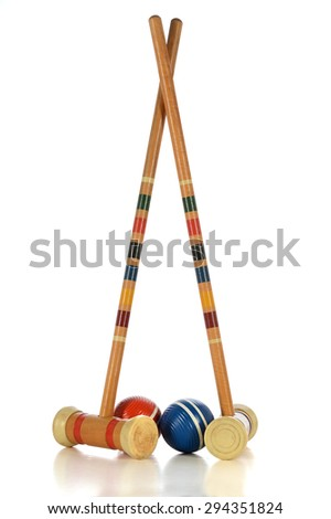 Vintage mallets and balls of croquet game isolated over white background - With clipping path - stock photo