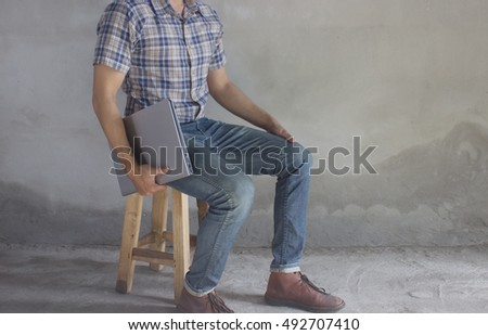 Vintage,Man wearing a plaid shirt,jeans,Leather shoe and Laptop