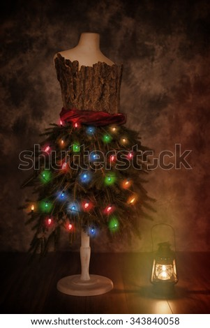 Vintage mannequin dressed for Christmas with old fashioned lamp - stock photo
