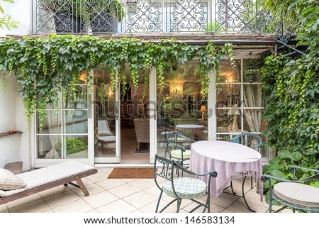Vintage mansion - a cosy veranda with an ivy - stock photo