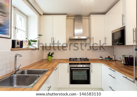 Vintage mansion - a white modern kitchen - stock photo