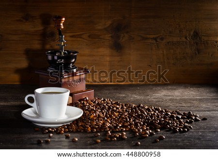 Vintage manual coffee grinder with coffee beans - stock photo