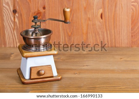 vintage manual coffee mill on wooden table