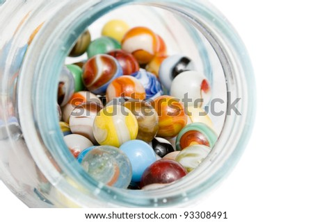 Vintage marbles in a glass jar