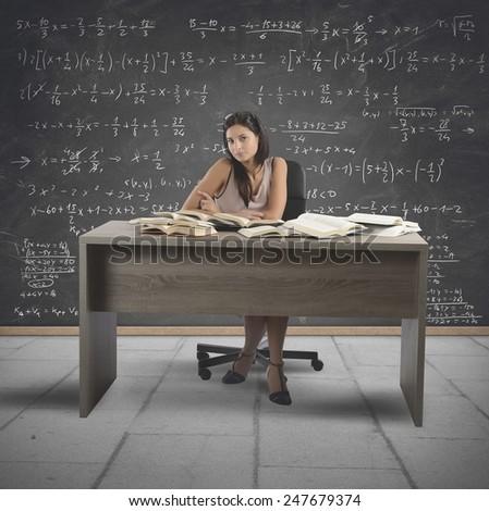 Vintage math teacher teaches in a school - stock photo