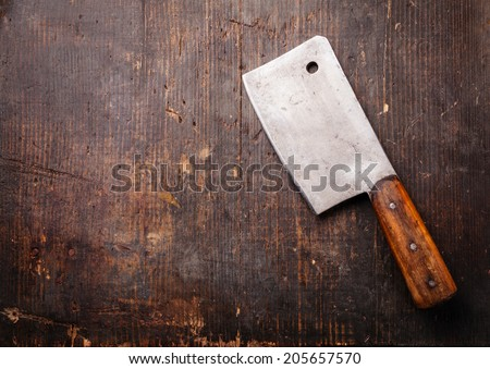 Vintage Meat cleaver on dark wooden background - stock photo