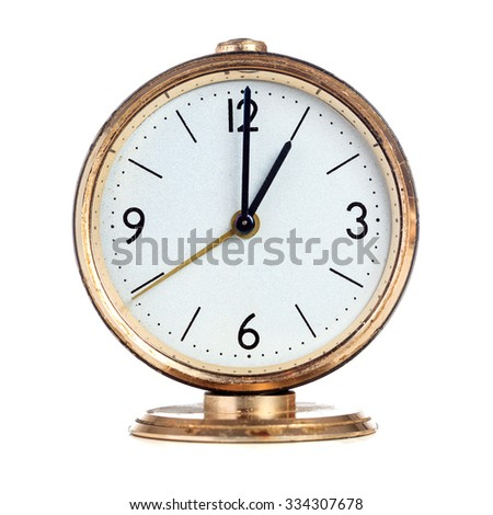 Vintage mechanical alarm clock showing one o'clock isolated over white - stock photo