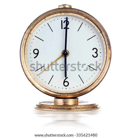 Vintage mechanical alarm clock showing six o'clock isolated over white - stock photo