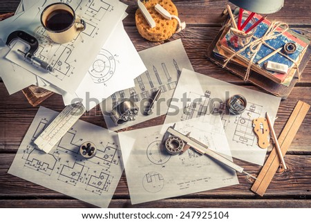 Vintage mechanical engineer desk - stock photo