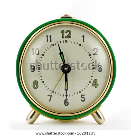 Vintage mechanical wind-up alarm clock over white isolated - stock photo