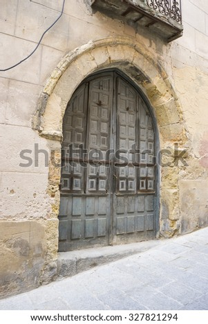 Vintage, medieval door Spanish city of Segovia. Old wooden entrance. ancient architecture - stock photo