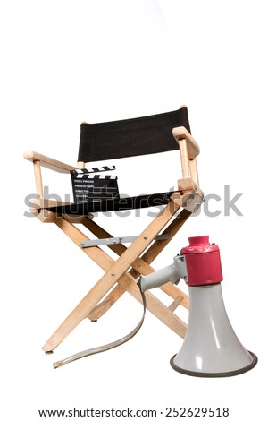 vintage megaphone and clapperboard on directors chair - stock photo