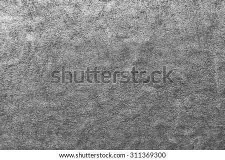 Vintage metal surface in tones of black, white, and gray/grey, for background, wallpaper, or advertising message. - stock photo