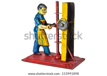 Vintage metal toy of a factory worker isolated on a white background - stock photo