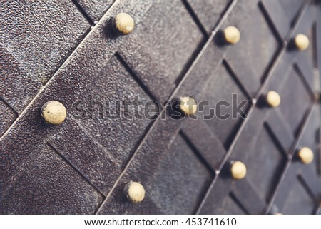Vintage metallic pattern of medieval gate. Decorative grunge checkered iron structure background. Architectural detail, selective focus - stock photo