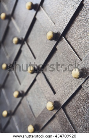 Vintage metallic pattern of medieval gate. Decorative grunge checkered iron structure background. Architectural detail vertical image, selective focus - stock photo