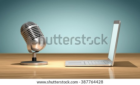 Vintage microphone in front of a laptop on a wooden table and oriented to record the sound. Concept of numerical recording or multimedia - stock photo