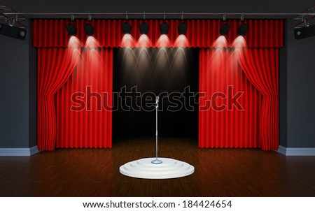 vintage microphone on Theater stage with red curtains and spotlights Theatrical scene in the light of searchlights, the interior of the old theater  - stock photo