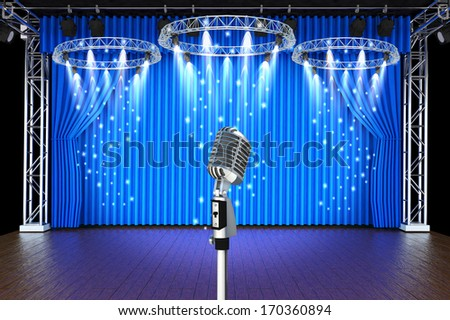 vintage microphone with spotlight in Theater stage with blue curtains background  - stock photo