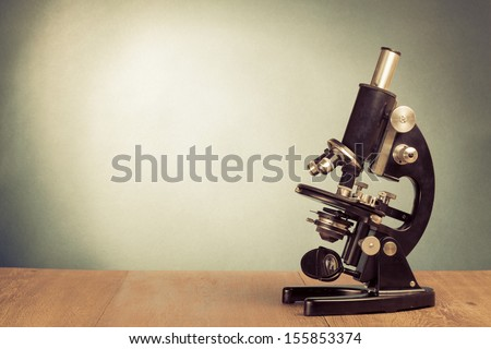 Vintage microscope on table for science background - stock photo