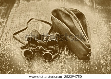 Vintage military binoculars and field cap. Feast of May 9 Victory Day, the anniversary - 70 years after World War II - stock photo