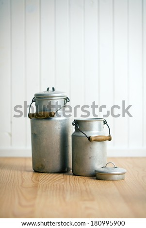vintage milk cans on wooden floor