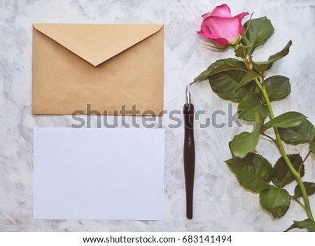 Vintage mockup. Blank paper and envelope, pink rose, pen. Wedding invitation