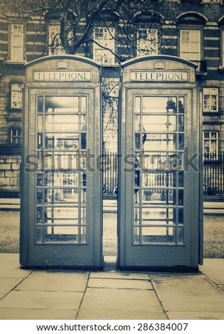 Vintage monochrome image of the famous phone booths in London