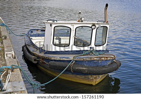 Vintage motor boat in  harbor - stock photo